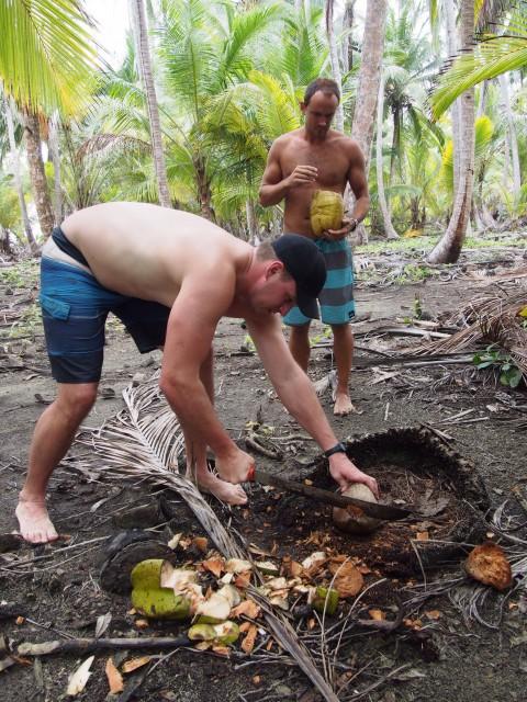 Breaking open coconuts San Blas Panama