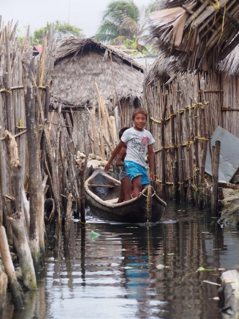 Local children taking a canoe, San Blas