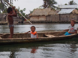 Children playing in a Canoe, San Blas