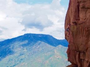 Climbing the red rock of La Mojarra, Colombia