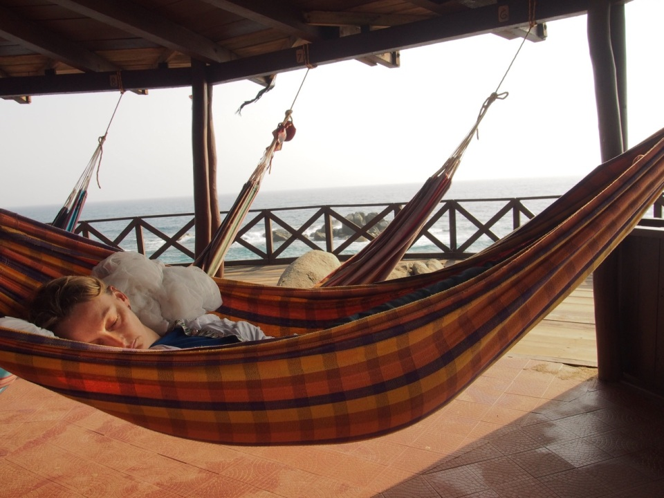 Jenny sleeping in an ocean view hammock in Tayrona National Park, Colombia