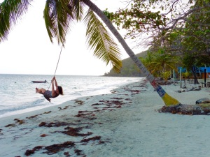 Swinging on Playa Manzanillo at sunset, Providencia