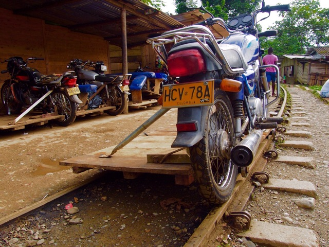 A motorbike on a railway is ready for passenger, San Cipriano